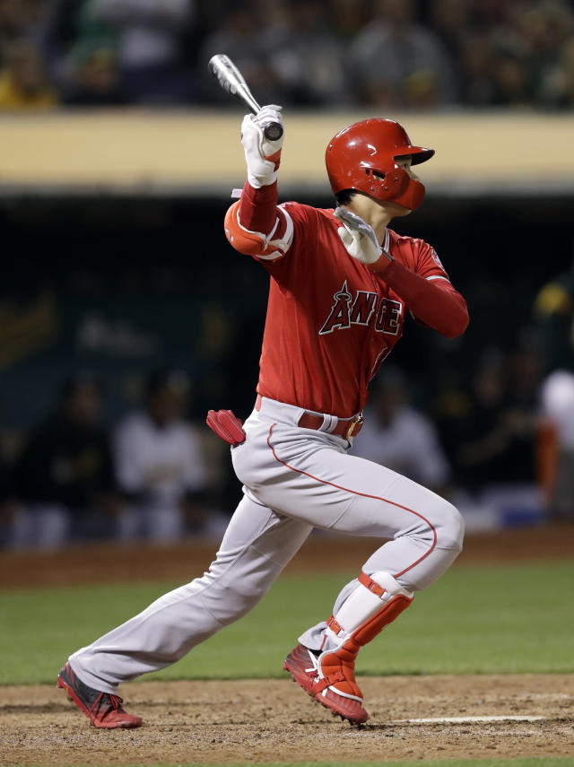Los Angeles Angels' Shohei Ohtani swings for a two-run single against the Oakland Athletics in the ninth inning of a baseball game, Tuesday, May 28, 2019, in Oakland, Calif. (AP Photo/Ben Margot)