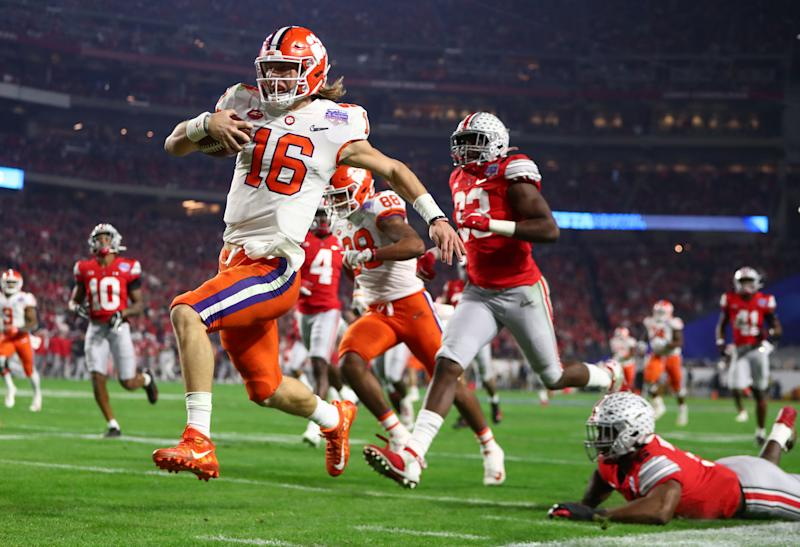 Dec 28, 2019; Glendale, AZ, USA; Clemson Tigers quarterback Trevor Lawrence (16) scores a touchdown against the Ohio State Buckeyes during the first half in the 2019 Fiesta Bowl college football playoff semifinal game at State Farm Stadium. Mandatory Credit: Mark J. Rebilas-USA TODAY Sports TPX IMAGES OF THE DAY