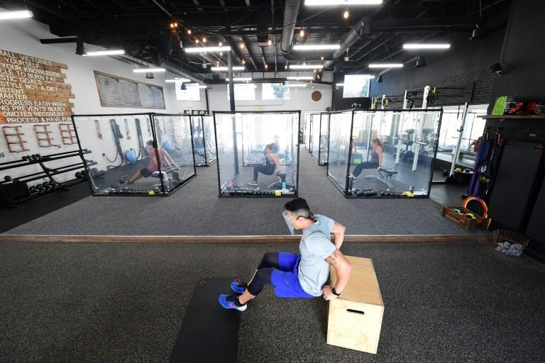 Gyms -- as well as shopping malls, hair salons and non-essential offices -- must close indoor operations in half of California's worst-hit and most densely populated counties, including Los Angeles (AFP Photo/FREDERIC J. BROWN)