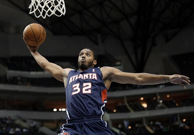 Atlanta Hawks forward Mike Scott goes up for a dunk on a breakaway play in the first half of a preseason NBA basketball game against the Dallas Mavericks, Wednesday, Oct. 23, 2013, in Dallas. (AP Photo/Tony Gutierrez)