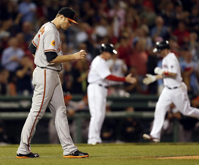 Baltimore Orioles' Chris Tillman looks at the ball after Boston Red Sox's Stephen Drew hit a two-run home run in the second inning of a baseball game in Boston, Thursday, Sept. 19, 2013. (AP Photo/Michael Dwyer)