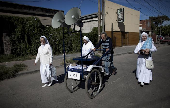 Nuns walk promoting the church's activities in the Villa 21-24 slum in Buenos Aires, Argentina, Sunday, March 17, 2013. Argentina's former cardinal Jorge Mario Bergoglio was chosen as leader of the Catholic Church on March 13, 2013, making him the New World's first pope. (AP Photo/Natacha Pisarenko)