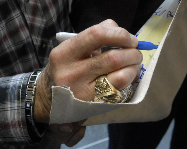 World Series rings adorn the fingers of Baseball Hall of Fame inductee Tony La Russa as he signs an autograph at the National Baseball Hall of Fame and Museum in Cooperstown, N.Y., Thursday, April 10, 2014. La Russa is scheduled to be inducted into the hall this summer. (AP Photo/Tim Roske)