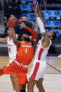 Syracuse forward Quincy Guerrier (1) drives on Houston forward Reggie Chaney (32) in the second half of a Sweet 16 game in the NCAA men's college basketball tournament at Hinkle Fieldhouse in Indianapolis, Saturday, March 27, 2021. (AP Photo/Michael Conroy)