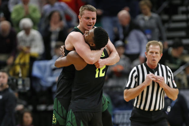 Baylor guard Makai Mason, left, and guard Jared Butler (12) celebrate the team's win against Syracuse in a first-round game in the NCAA mens college basketball tournament Thursday, March 21, 2019, in Salt Lake City. (AP Photo/Jeff Swinger)