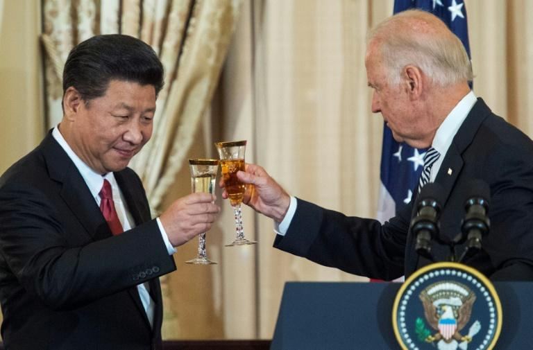 Then-Vice President Joe Biden and Chinese President Xi Jinping toast each other in 2015; late Wednesday Biden had his first phone call as US president with Xi.