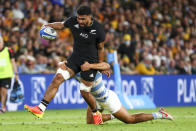 New Zealand's Hoskins Sotutu runs at the defense during the Rugby Championship test match between the All Blacks and the Pumas in Brisbane, Australia, Saturday, Sept. 18, 2021. (AP Photo/Tertius Pickard)