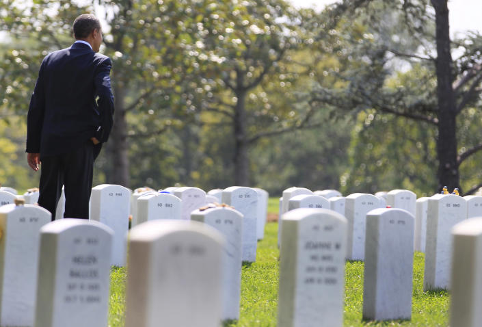 """FILE - In this Saturday, Sept. 10, 2011 file photo, President Barack Obama looks out over graves in Section 60 at Arlington National Cemetery in Arlington, Va., where he paid his respects to those who have made the ultimate sacrifice in the past decade. It was once President Barack Obama's """"war of necessity."""" Now, it's America's forgotten war. The Afghan conflict generates barely a whisper on the U.S. presidential campaign trail. It's not a hot topic at the office water cooler or in the halls of Congress _ even though 88,000 American troops are still fighting here and dying at a rate of one a day.(AP Photo/Carolyn Kaster, File)"""