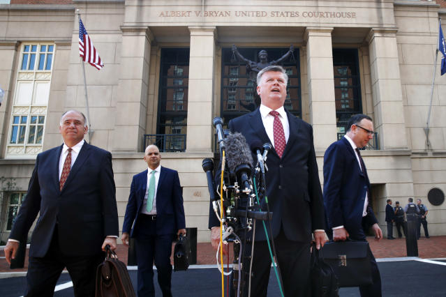 <p>Defense attorney Kevin Downing, second from right, makes a statement to the media after leaving federal court in the trial of former Donald Trump campaign chairman Paul Manafort, in Alexandria, Va., Tuesday, Aug. 14, 2018. (Photo: Jacquelyn Martin/AP) </p>