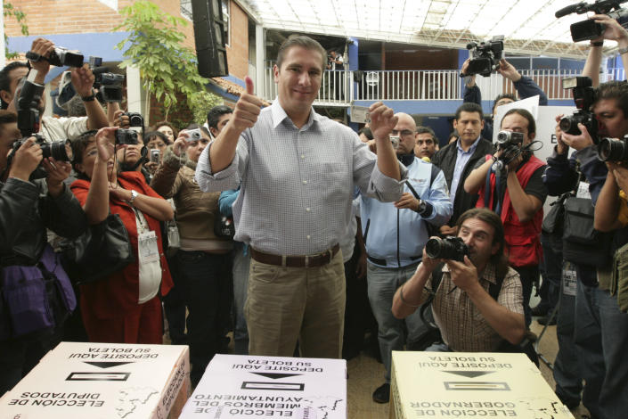 """FILE - In this July 4, 2010 file photo, Rafael Moreno Valle, candidate of the """"Compromiso por Puebla"""" party coalition, flashes two thumbs up after casting his vote during state elections in Puebla, Mexico. Moreno Valle, who went on to win the 2010 gubernatorial race, died in what local media are reporting as a helicopter crash on Christmas Eve, Monday, Dec. 24, 2018, along with his wife Martha Erika Alonso, who is currently the governor of Puebla. (AP Photo/Joel Merino, File)"""