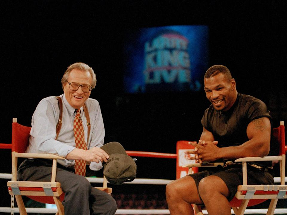 Heavyweights: Mike Tyson sharing a laugh with King in Las Vegas, 1995AP