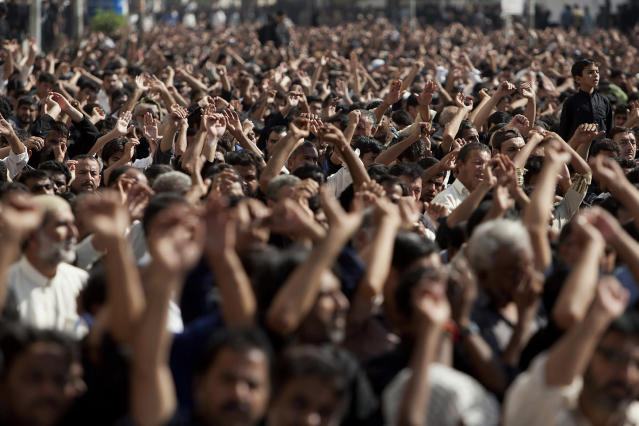 <p>Pakistani Shiite Muslims chant religious slogans during an Ashoura procession in Karachi, Pakistan, Nov. 15, 2013. Ashoura commemorates the martyrdom of Imam Hussein, the grandson of Prophet Muhammad at the Battle of Karbala, Iraq, in the year 680 A.D. (AP Photo/Shakil Adil) </p>