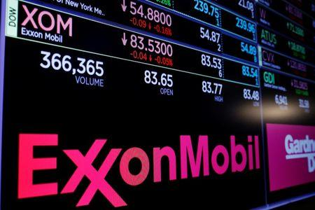 A logo of Exxon Mobil is displayed on a monitor above the floor of the New York Stock Exchange shortly after the opening bell in New York