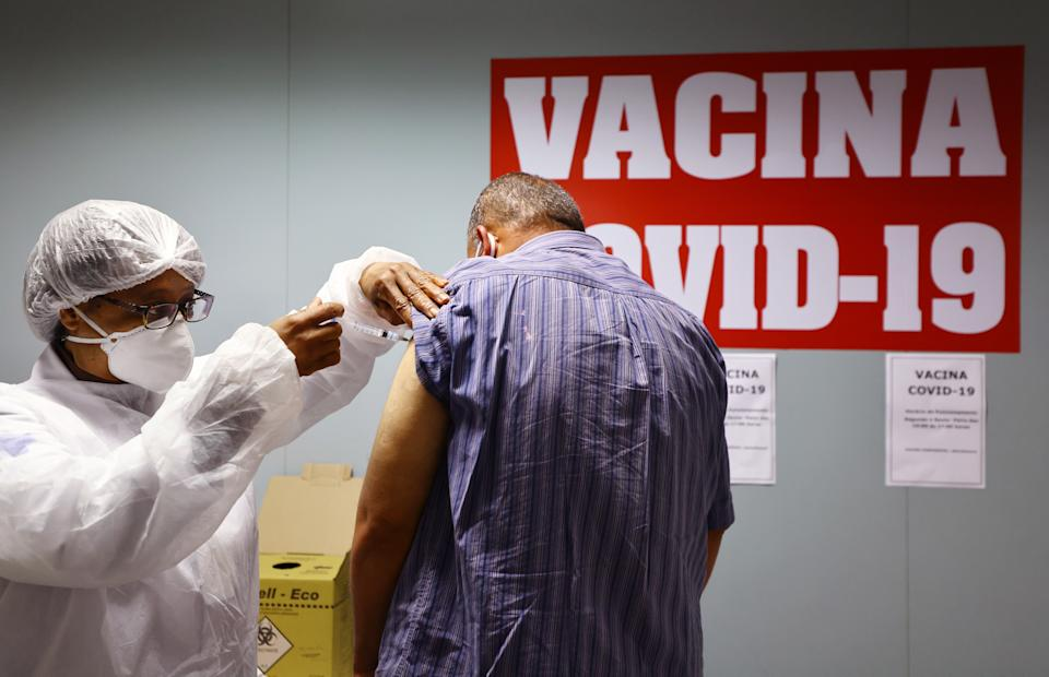 SAO PAULO, BRAZIL - MAY 20: A health worker administers a dose of the COVID-19 vaccine to a person at a vaccination post inside the Republica subway station on May 20, 2021 in Sao Paulo, Brazil. Vaccinations for eligible people are available in a number of public transportation stations in the city. Health experts are warning that Brazil should brace for a new surge of COVID-19 amid a slow vaccine rollout and relaxed restrictions. The state of Sao Paulo has registered over 3 million cases of COVID-19 and more than 100,000 deaths. Over 440,000 people have been killed in Brazil by COVID-19, second only to the U.S. (Photo by Mario Tama/Getty Images)
