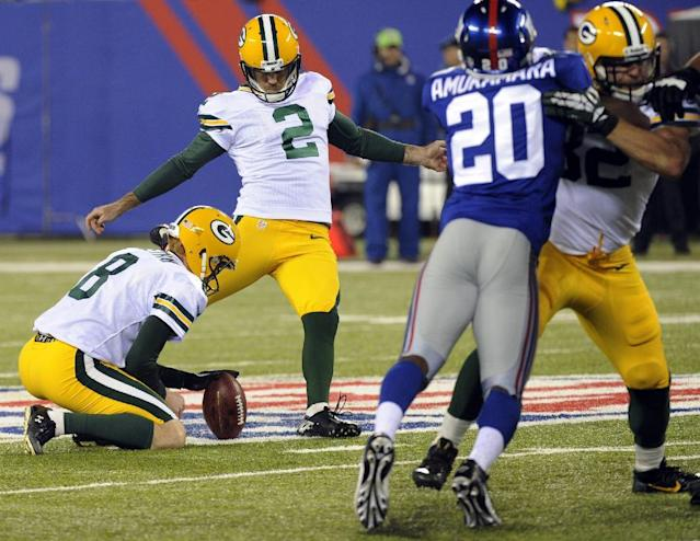 Green Bay Packers' Mason Crosby (2) kicks a field goal during the first half of an NFL football game Sunday, Nov. 17, 2013, in East Rutherford, N.J. (AP Photo/Bill Kostroun)