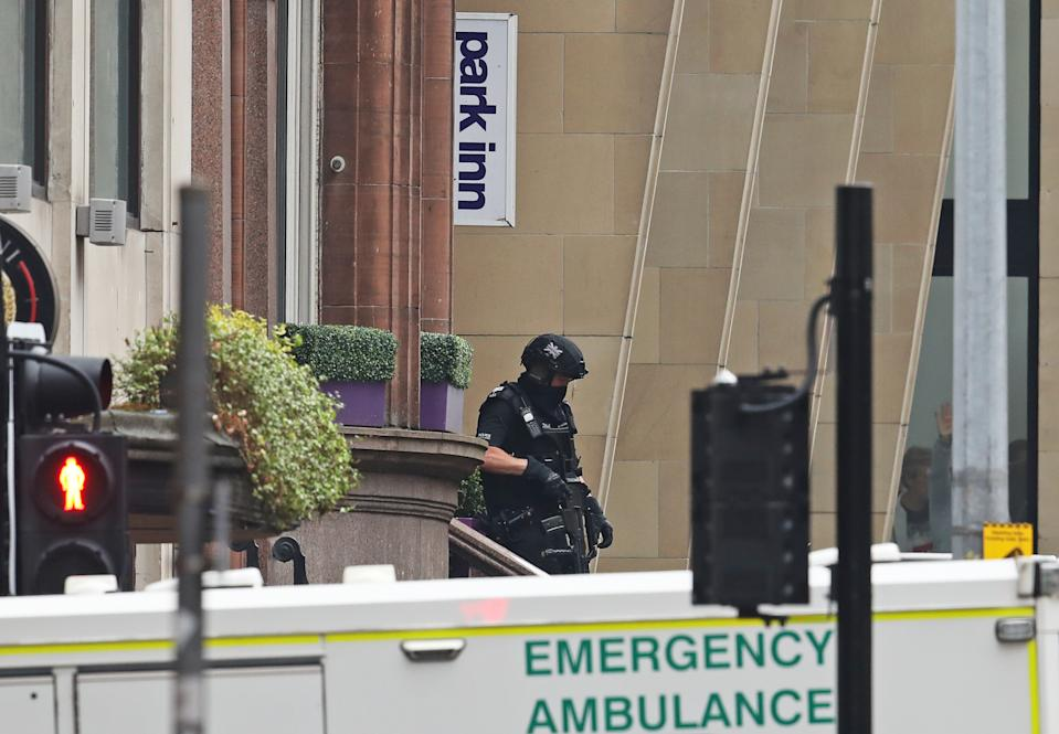 Armed police at the scene in West George Street, Glasgow. (PA)