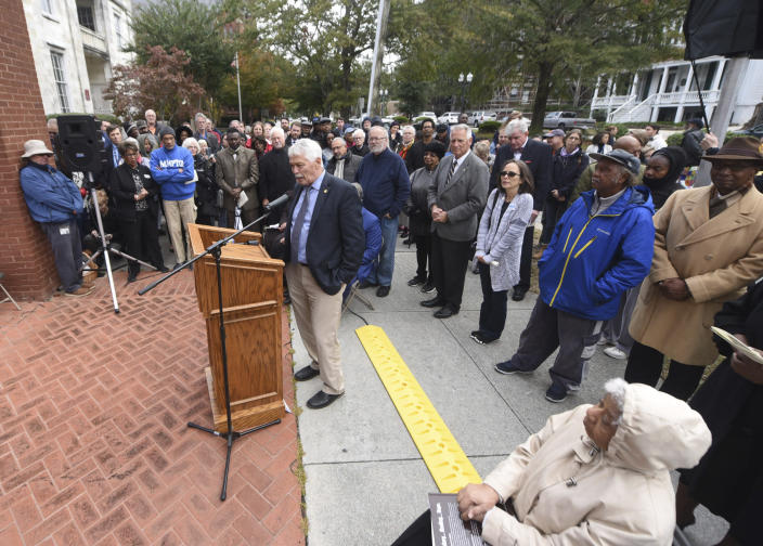 State Sen. Harper Peterson speaks during a dedication ceremony for a new North Carolina highway historical marker to the 1898 Wilmington Coup in Wilmington, N.C., Friday, Nov. 8, 2019. The marker stands outside the Wilmington Light Infantry building, the location where in 1898, white Democrats violently overthrew the fusion government of legitimately elected blacks and white Republicans in Wilmington. (Matt Born/The Star-News via AP)