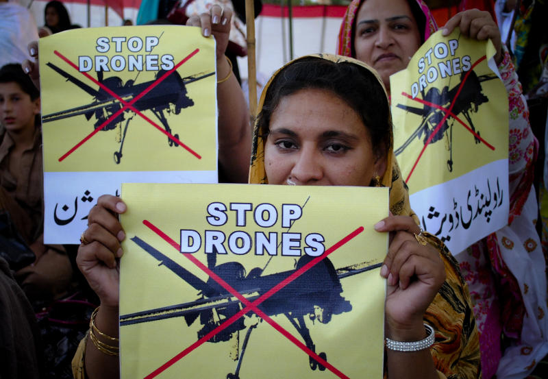 FILE - In this Saturday, April 23, 2011 file photo, women supporters of a political party rally against the U.S. drone strikes in Pakistani tribal areas, in Peshawar, Pakistan. The U.S. has drastically scaled back the number of drone attacks against militants in Pakistan and limited strikes to high-value targets in response to growing criticism. Those actions appear to have temporarily appeased Pakistan's powerful generals, but some U.S. are still worried about pushback from Pakistan's new civilian leaders, who took power in June with a strong stance on ending the attacks altogether. (AP Photo/Mohammad Sajjad, File)