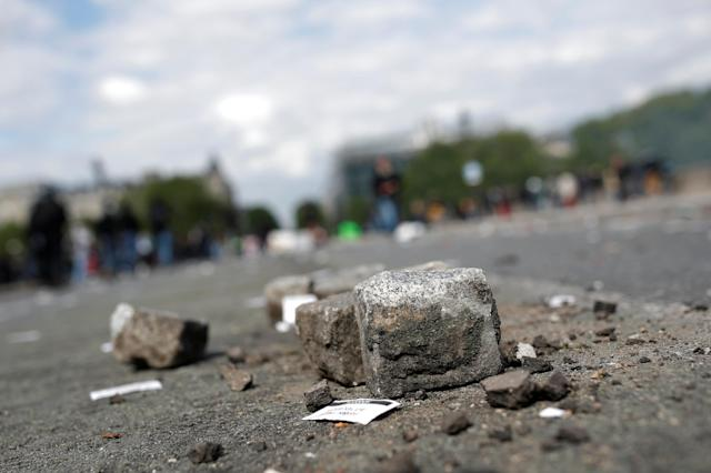 <p>Paving stones are scattered on the street after clashes at the May Day labour union rally in Paris, France, May 1, 2018. (Photo: Christian Hartmann/Reuters) </p>