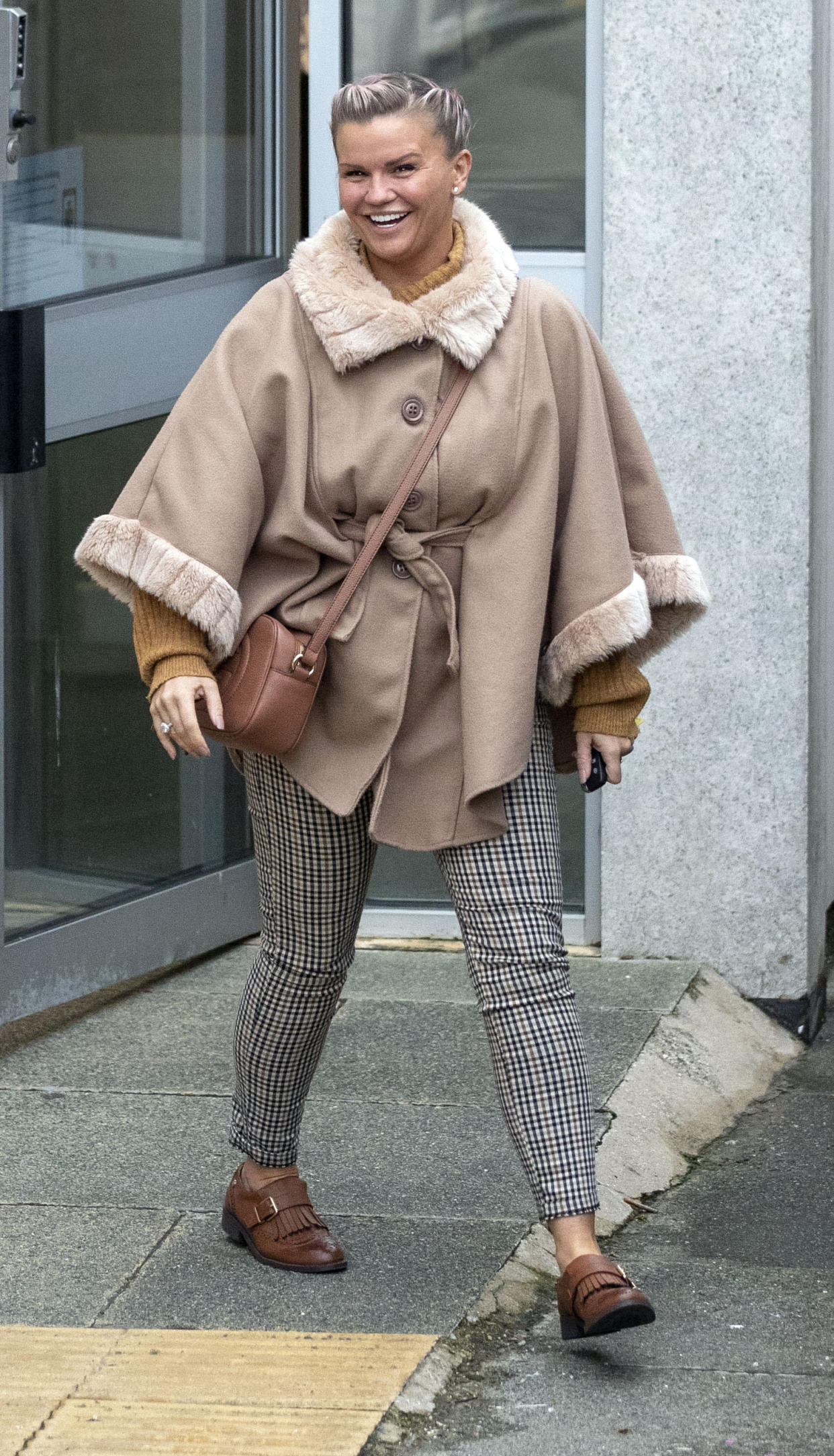 Kerry Katona leaves Brighton Magistrates' Court where she is charged with failing to send a child to school.