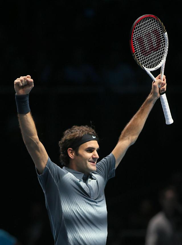 Roger Federer of Switzerland celebrates at match point after he wins against Juan Martin Del Potro of Argentina during their ATP World Tour Finals tennis match at the O2 Arena in London, Saturday, Nov. 9, 2013. (AP Photo/Alastair Grant)