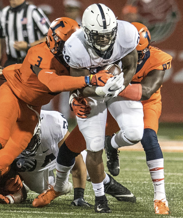 Penn State running back Miles Sanders (24) tries to break the tackle of Illinois's Del'Shawn Phillips (3) during the first half of an NCAA college football game Friday, Sept. 21, 2018, in Champaign, Ill. (AP Photo/Holly Hart)