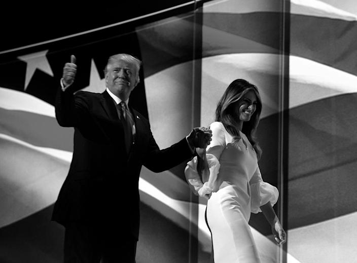 <p>Donald Trump walks off with his wife, Melania, after she spoke at the Republican National Convention on Monday. (Photo: Khue Bui for Yahoo News)</p>