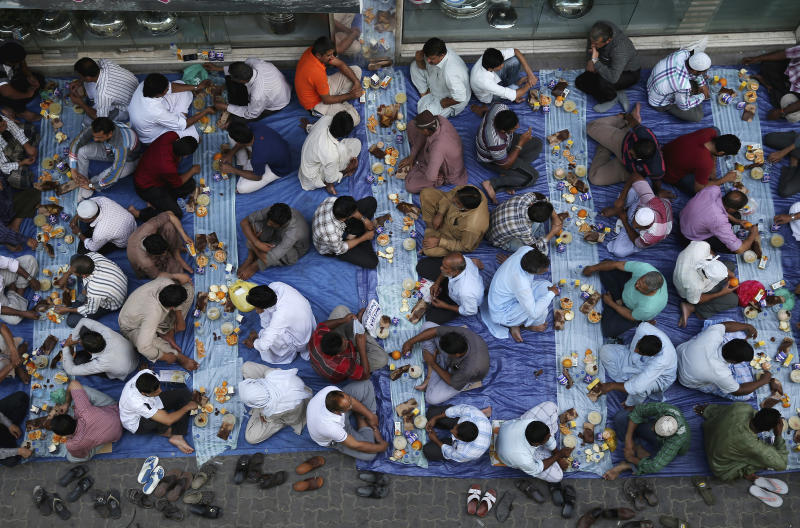 Muslims break their fast with iftar during the holy month of Ramadan at Lootha Mosque, Bur Dubai on July 1, 2014 in Dubai, United Arab Emirates.