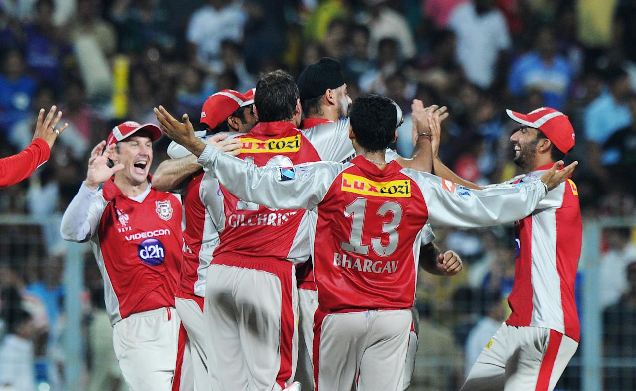 Kings XI Punjab players celebrate their win against Kolkata Knight Riders during their IPL Twenty20 cricket match between Kolkata Knight Riders and Kings XI Punjab at The Eden Gardens in Kolkata on April 15, 2012. RESTRICTED TO EDITORIAL USE. MOBILE USE WITHIN NEWS PACKAGE. AFP PHOTO/Dibyangshu SARKAR (Photo credit should read DIBYANGSHU SARKAR/AFP/Getty Images)