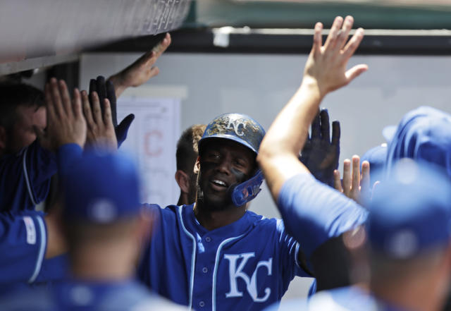 Kansas City Royals' Jorge Soler is congratulated by teammates after hitting a solo home run in the third inning of a baseball game against the Cleveland Indians, Sunday, July 21, 2019, in Cleveland. (AP Photo/Tony Dejak)