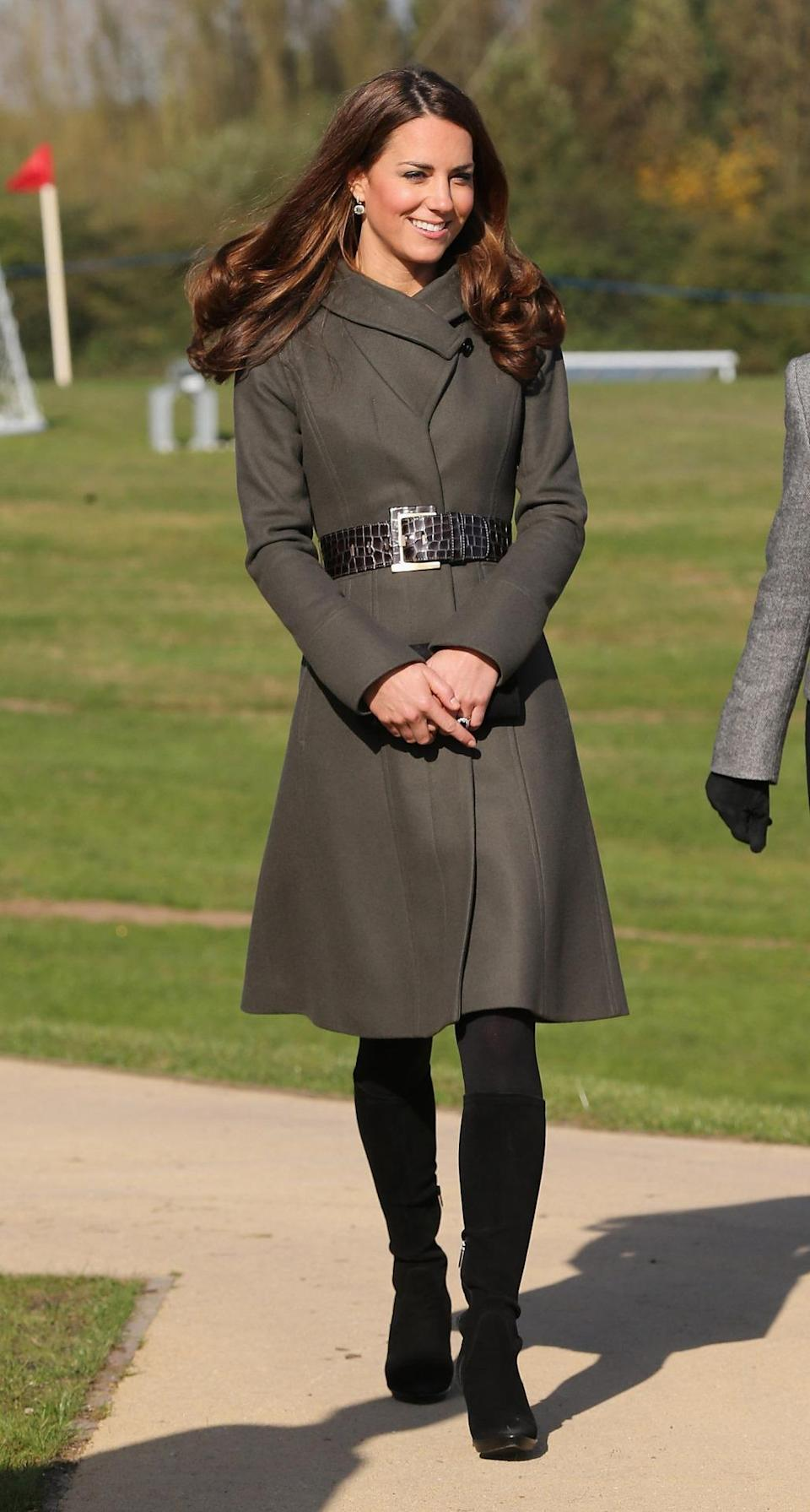 <p>Kate attended the opening of a football park in a khaki Reiss coat accessorised with a leather belt (also from Reiss). As usual, she wore knee high suede boots by Aquatalia. </p><p><i>[Photo: PA]</i></p>