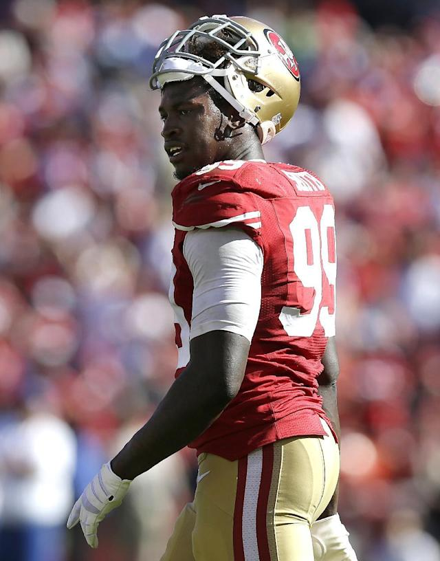 San Francisco 49ers linebacker Aldon Smith (99) walks on the field during the fourth quarter of an NFL football game against the Indianapolis Colts in San Francisco, Sunday, Sept. 22, 2013. (AP Photo/Marcio Jose Sanchez)