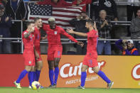 U.S. players celebrate after forward Gyasi Zardes (9) scored a goal against Canada during the first half of a CONCACAF Nations League soccer match Friday, Nov. 15, 2019, in Orlando, Fla. (AP Photo/John Raoux)