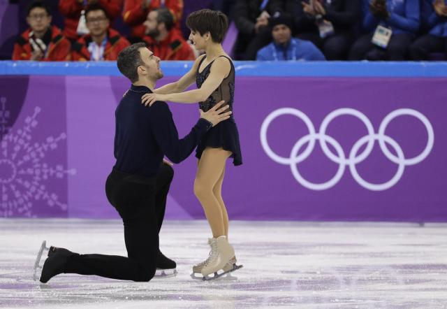 Meagan Duhamel and Eric Radford of Canada react following their performance in the pair skating short program team event at the 2018 Winter Olympics in Gangneung, South Korea, Friday, Feb. 9, 2018. (AP Photo/David J. Phillip)