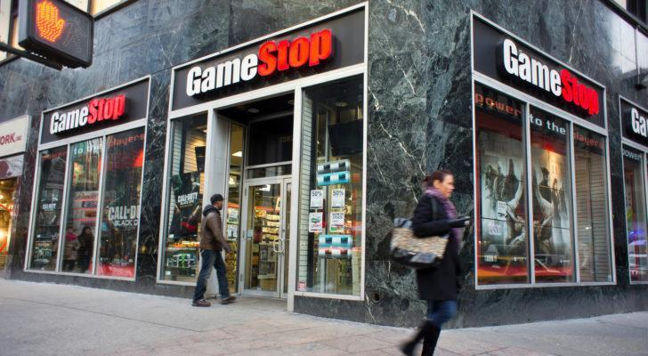 GameStop (GME) Store at a street corner with people walking past it