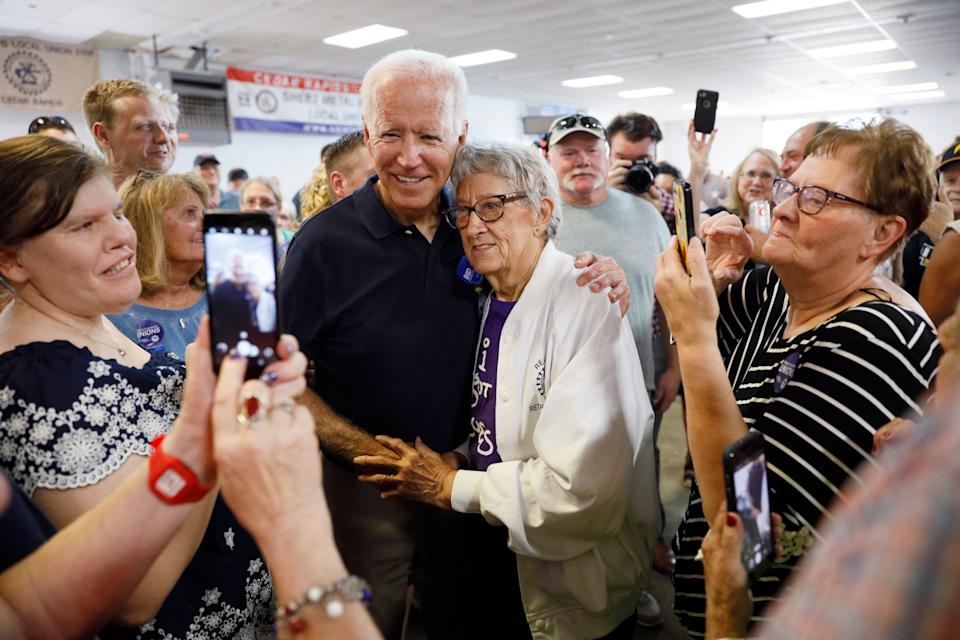 Democratic presidential candidate former Vice President Joe Biden gets a hug from Ruth Nowadzky, of Cedar Rapids, Iowa, during the Hawkeye Area Labor Council Labor Day Picnic, Monday, Sept. 2, 2019, in Cedar Rapids, Iowa. (Photo: ASSOCIATED PRESS)