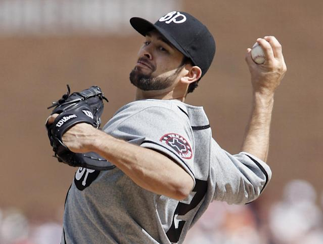 Texas Rangers starting pitcher Nick Martinez delivers against the Detroit Tigers in the first inning of a baseball game on Saturday, May 24, 2014, in Detroit. (AP Photo/Duane Burleson)