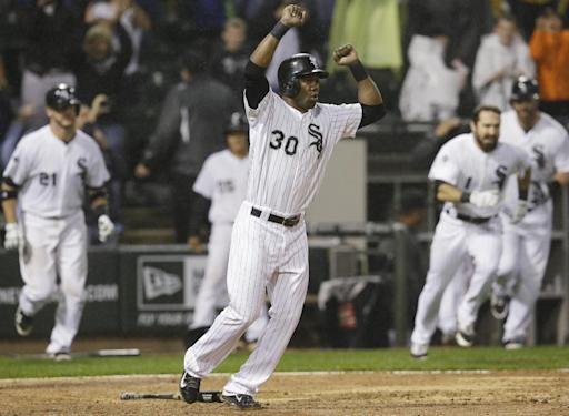 Chicago White Sox's Alejandro De Aza (30) celebrates after scoring on the game-winning single hit by Leury Garcia during the ninth inning of a baseball game against the Los Angeles Angels in Chicago on Wednesday, July 2, 2014. The White Sox won 3-2. (AP Photo/Nam Y. Huh)