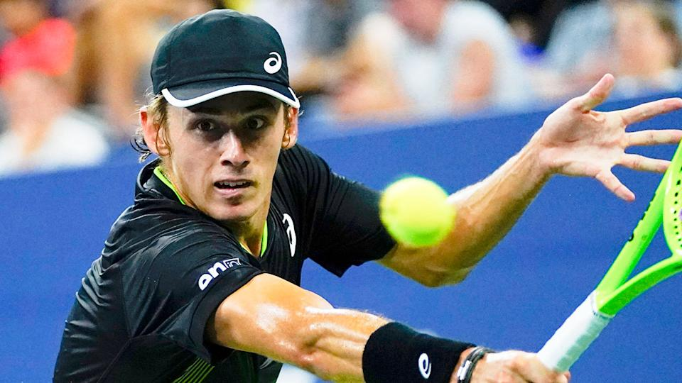 Seen here, Alex de Minaur plays a shot against Taylor Fritz in the first round of the US Open.