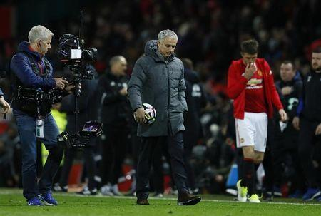 Manchester United manager Jose Mourinho walks off dejected after the game