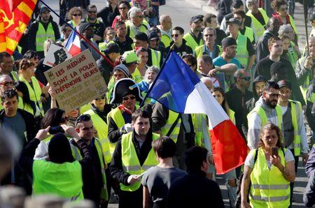 """Protesters wearing yellow vests take part in a demonstration of the """"yellow vests"""" movement in Marseille, France, February 23, 2019. REUTERS/Jean-Paul Pelissier"""