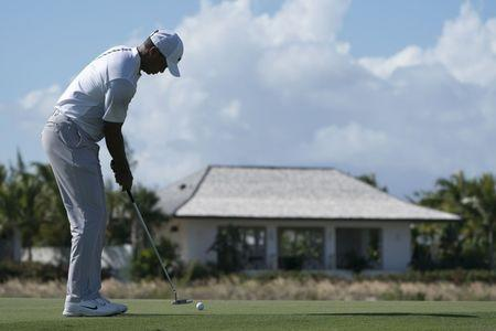 December 1, 2017; New Providence, The Bahamas; Tiger Woods putts on the fifth hole during the second round of the Hero World Challenge golf tournament at Albany. Kyle Terada-USA TODAY Sports