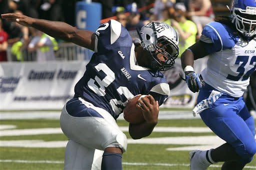 New Hampshire's Jimmy Owens (32) runs with the ball as Central Connecticut State's Patrick Atkinson (32) looks to tackle in the second half of their NCAA college football game,Saturday, Sept. 15, 2012,in Durham, N.H. New Hampshire won 43-10. (AP Photo/Cheryl Senter)