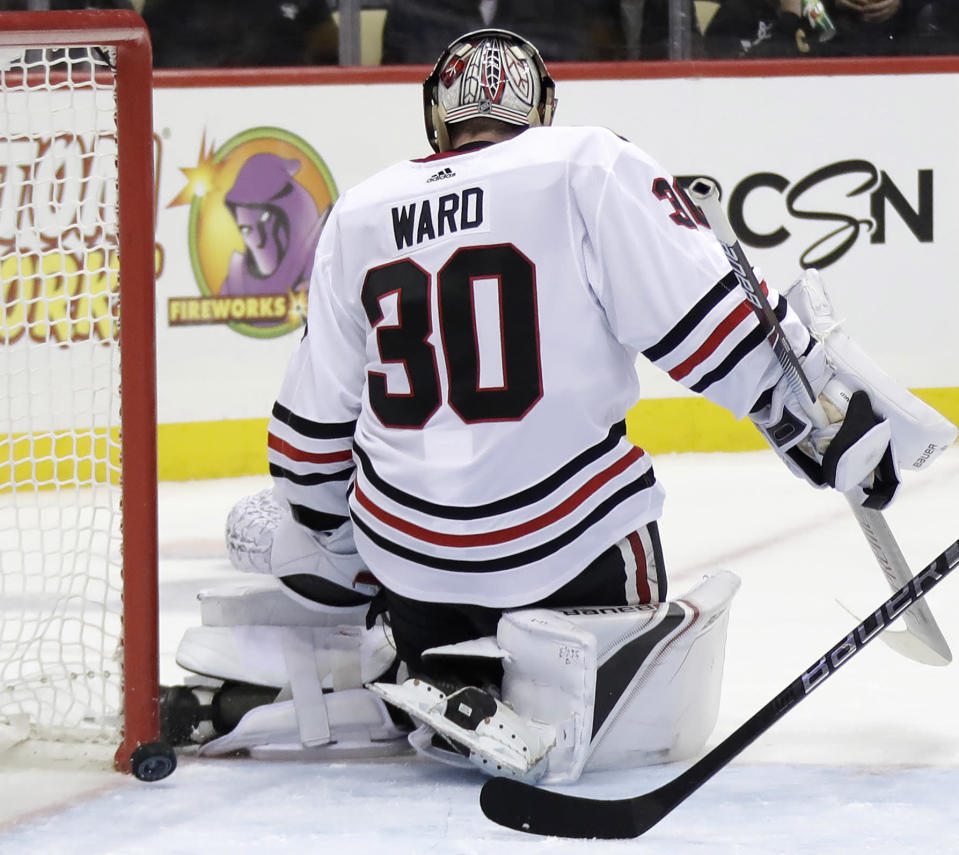 A shot by Pittsburgh Penguins' Derick Brassard gets between the pads of Chicago Blackhawks goaltender Cam Ward (30) for a goal in the second period of an NHL hockey game in Pittsburgh, Sunday, Jan. 6, 2019. (AP Photo/Gene J. Puskar)