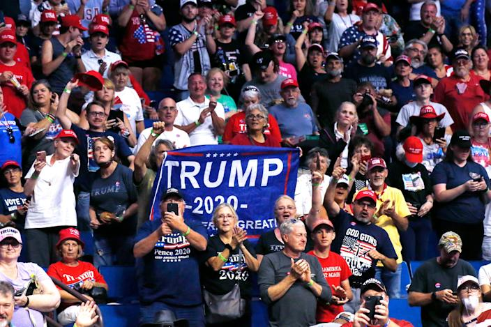 President Donald Trump supporters cheer Eric Trump, the son of President Trump, not pictured, before a Trump campaign rally in Tulsa, Okla., Saturday, June 20, 2020.