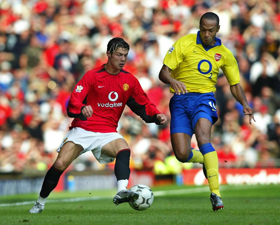 Manchester United's Cristiano Ronaldo (left) tries to hold off a challenge by Arsenal's Thierry Henry, during their FA Barclaycard Premiership match at Old Trafford, Manchester. THIS PICTURE CAN ONLY BE USED WITHIN THE CONTEXT OF AN EDITORIAL FEATURE. NO WEBSITE/INTERNET USE UNLESS SITE IS REGISTERED WITH FOOTBALL ASSOCIATION PREMIER LEAGUE. (Photo by Martin Rickett - PA Images/PA Images via Getty Images)