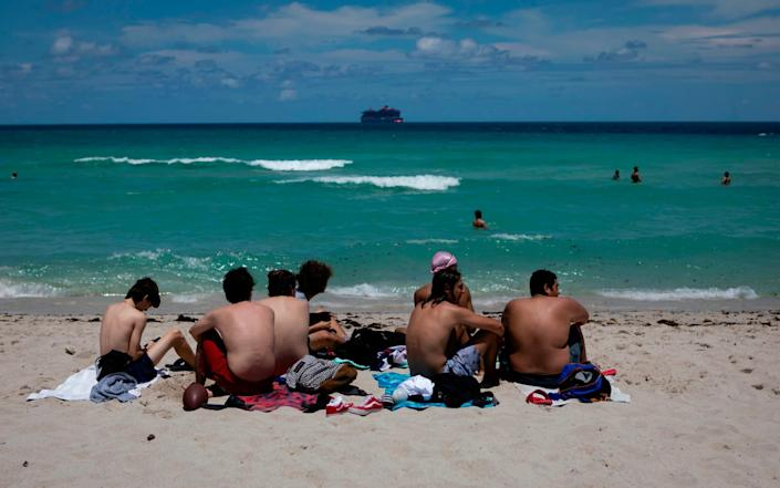 Beachgoers sunbathe in Miami Beach, Florida on June 16, 2020 - AFP