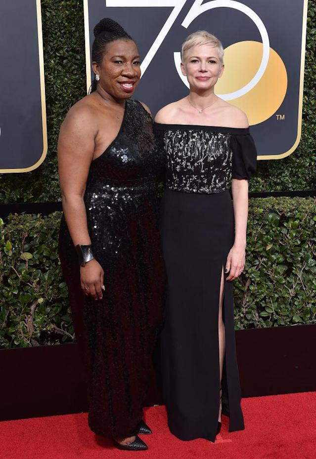Activist Tarana Burke and actress Michelle Williams attend the Golden Globe Awards on Jan. 7. (Photo: Axelle/Bauer-Griffin/FilmMagic)