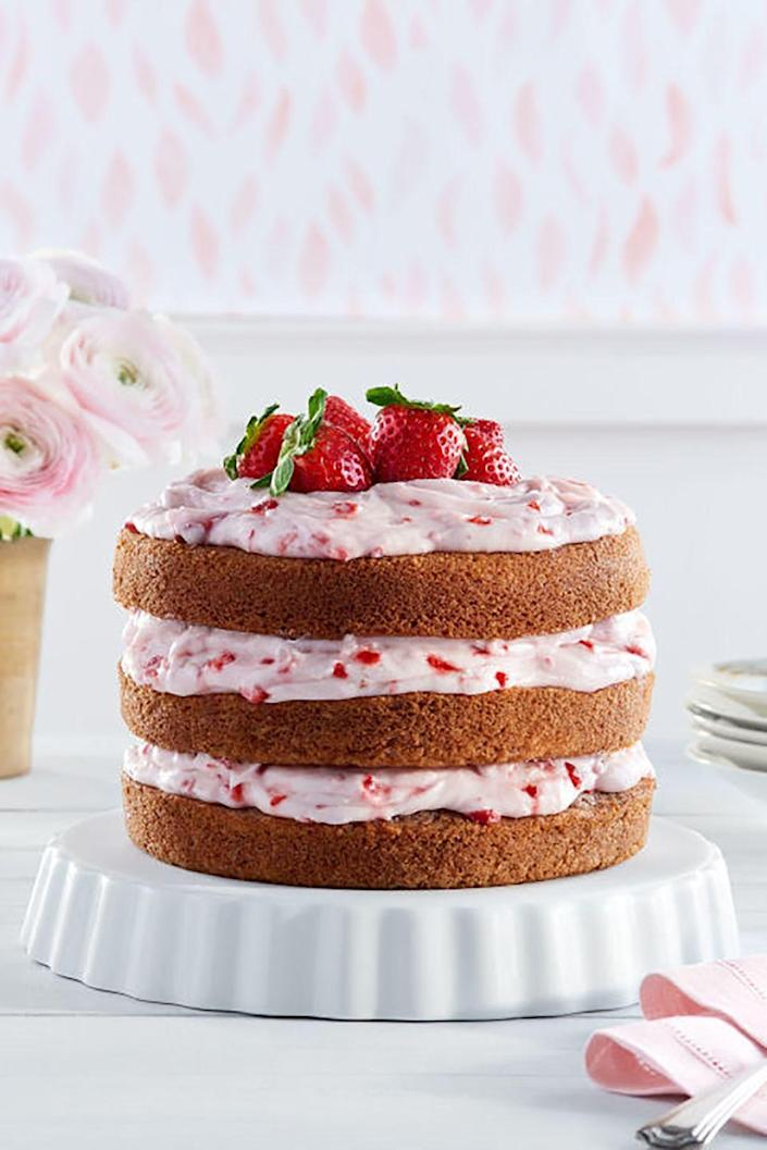 """<p>The strawberry cream cheese frosting on this gorgeous cake is irresistible. </p><p><strong><a href=""""https://www.countryliving.com/food-drinks/recipes/a37720/strawberry-limeade-cake-strawberry-cream-cheese-frosting-recipe/"""" rel=""""nofollow noopener"""" target=""""_blank"""" data-ylk=""""slk:Get the recipe"""" class=""""link rapid-noclick-resp"""">Get the recipe</a>.</strong></p><p><a class=""""link rapid-noclick-resp"""" href=""""https://go.redirectingat.com?id=74968X1596630&url=https%3A%2F%2Fwww.williams-sonoma.com%2Fproducts%2Fkitchenaid-artisan-mini-with-flex-edge-beater%2F&sref=https%3A%2F%2Fwww.countryliving.com%2Ffood-drinks%2Fg3185%2Fmothers-day-cakes%2F"""" rel=""""nofollow noopener"""" target=""""_blank"""" data-ylk=""""slk:SHOP STAND MIXERS"""">SHOP STAND MIXERS</a></p>"""