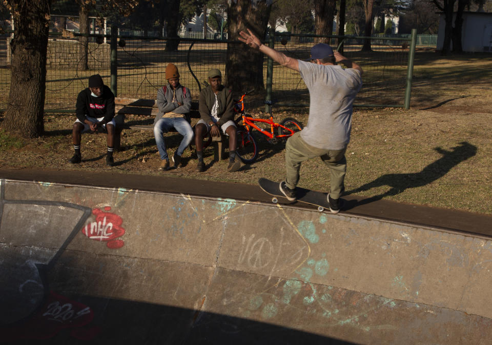 Skateboarder Dallas Oberholzer, 46, rides at the Germiston Lake Skateboard Park, near Johannesburg, Saturday, July 3, 2021. The age-range of competitors in skateboarding's Olympic debut at the Tokyo Games is remarkably broad and 46-year-old Dallas Oberholzer will go wheel-to-wheel with skaters less than half his age. (AP Photo/Denis Farrell)